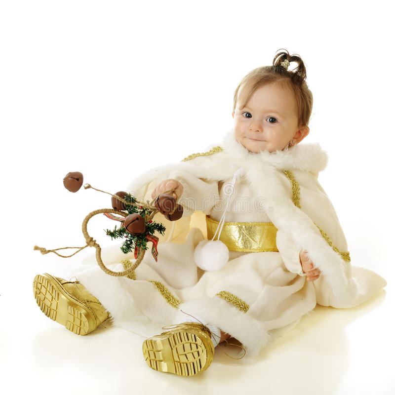 Jingle Bell Princess. An adorable baby snow princess happily playing with a bunch of jingle bells. On a white background stock photos