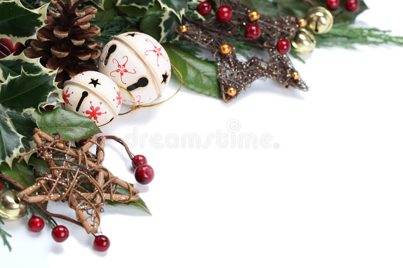 Jingle bell and star Christmas border. Christmas border with jingle bells, stars and other Christmas ornaments and decorations isolated on white. Shallow dof royalty free stock photo