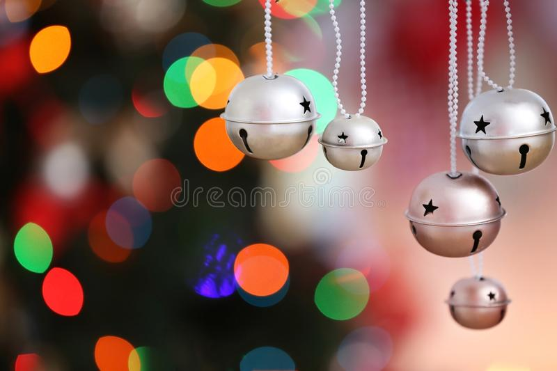 Jingle bells on blurred Christmas lights background,. Closeup royalty free stock photos