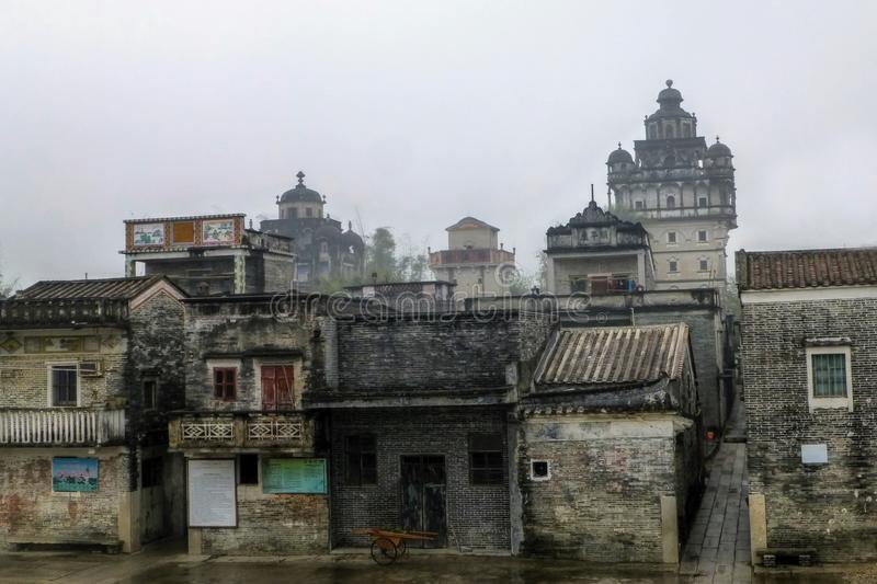 Jinjiang village in Guangdong province in China. The Ruishi Diaolou (watchtower) was constructed in 1921 and it is the most famous one. It features a Byhantine stock image