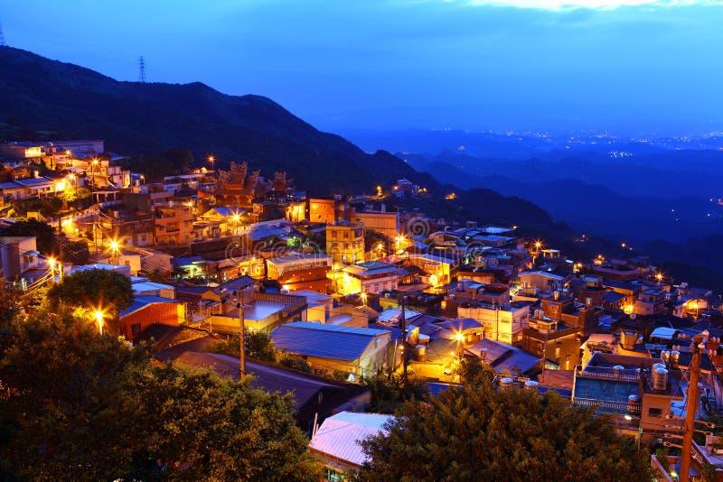 Jiu市分村庄在晚上, 库存图片