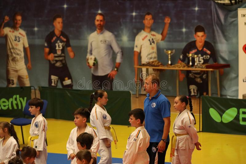 Jiu Jitsu fighter waiting, ready for training. Jiu Jitsu junior student in Kimono on tatami. Jiu-Jitsu Romanian Championship took place in Constanta, Sala stock photo