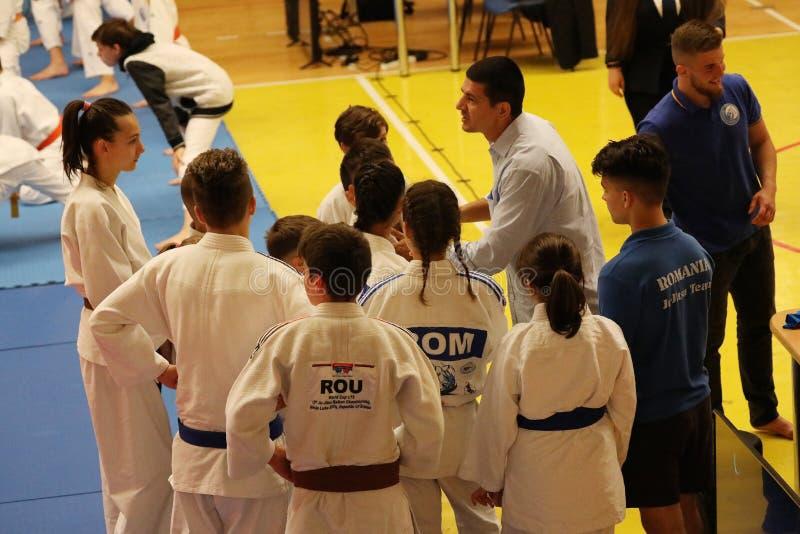 Jiu Jitsu fighter waiting, ready for training. Jiu Jitsu junior student in Kimono on tatami. Jiu-Jitsu Romanian Championship took place in Constanta, Sala stock photography