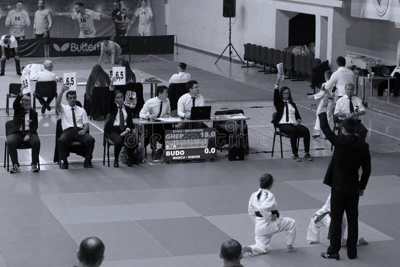 Jiu Jitsu girls fighters. Jiu Jitsu students in Kimono with Referee on tatami. Jiu-Jitsu Romanian Championship took place in Constanta, Sala Sporturilor, May royalty free stock photo