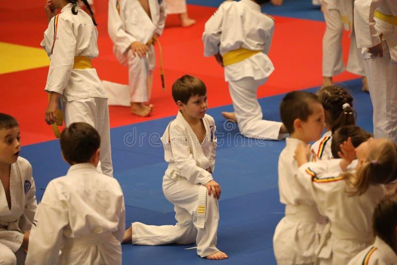Jiu Jitsu junior fighters at Romanian Championship, Juniors, May 2018. Jiu Jitsu students in Kimono on tatami. Jiu-Jitsu Romanian Championship took place in royalty free stock photos