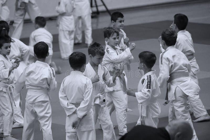 Jiu Jitsu junior fighters at Romanian Championship, Juniors, May 2018. Jiu Jitsu students in Kimono on tatami. Jiu-Jitsu Romanian Championship took place in royalty free stock image