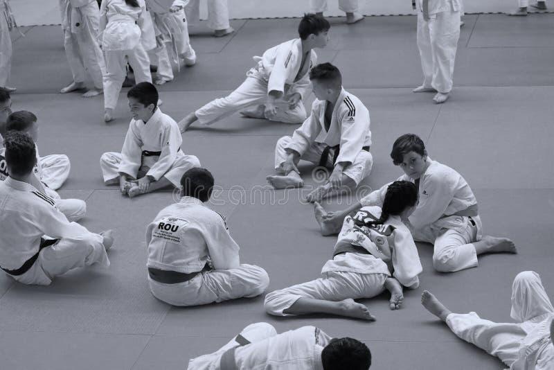Jiu Jitsu junior fighters at Romanian Championship, Juniors, May 2018. Jiu Jitsu students in Kimono on tatami. Jiu-Jitsu Romanian Championship took place in stock photo