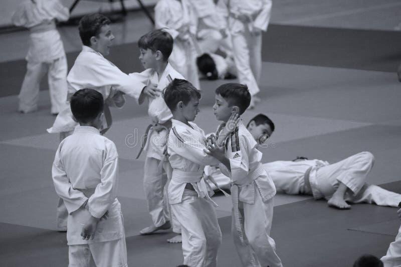 Jiu Jitsu junior fighting at Romanian Championship, Juniors, May 2018. Jiu Jitsu students in Kimono on tatami. Jiu-Jitsu Romanian Championship took place in stock photo