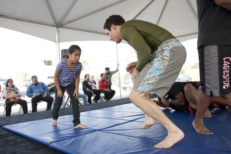 Jiu Jitsu Kid. LOS ANGELES - SEPT 25: Villa Park Jiu-Jitsu teaching self defense to kids at Little Tokyo's Cherry Blossom Festival on September 25, 2011 in Los stock photo