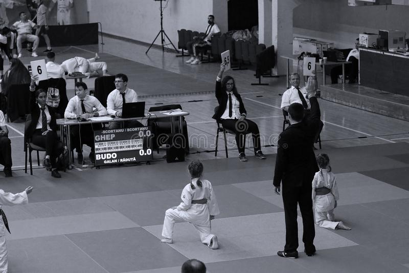 Jiu Jitsu girls fighters. Jiu Jitsu students in Kimono with Referee on tatami. Jiu-Jitsu Romanian Championship took place in Constanta, Sala Sporturilor, May royalty free stock images