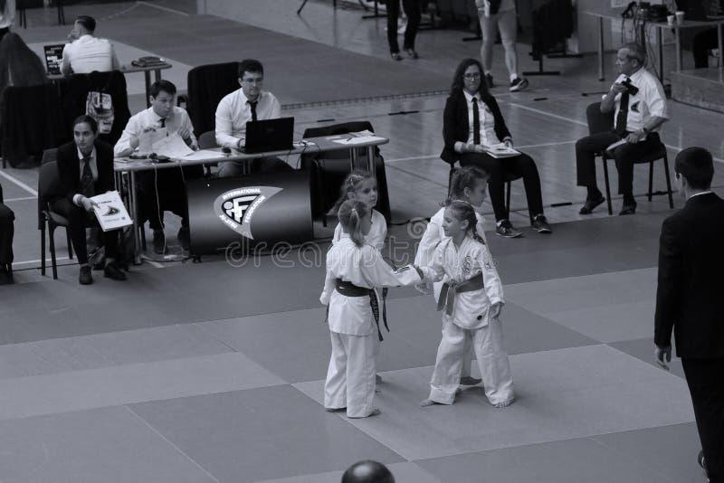 Jiu Jitsu girls fighters. Jiu Jitsu students in Kimono with Referee on tatami. Jiu-Jitsu Romanian Championship took place in Constanta, Sala Sporturilor, May royalty free stock photos