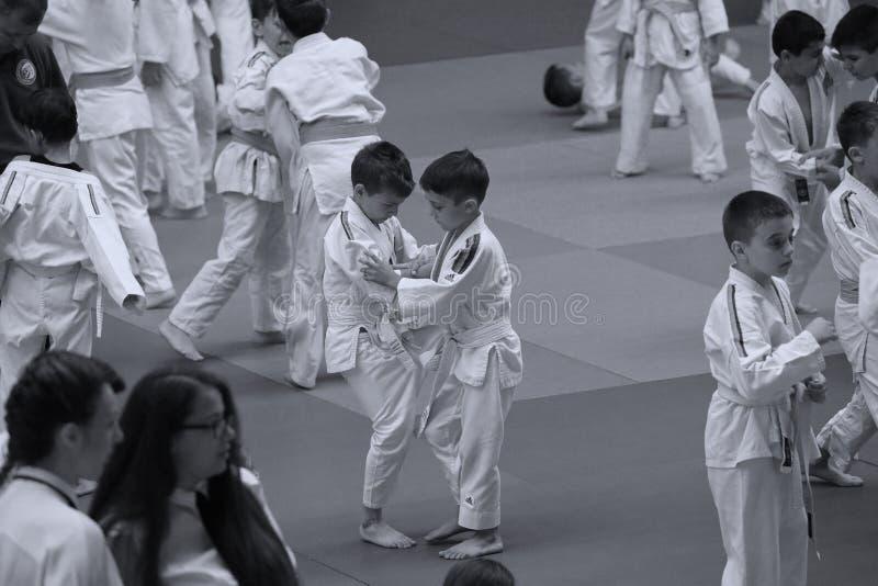 Jiu Jitsu junior fighters at Romanian Championship, Juniors, May 2018. Jiu Jitsu students in Kimono on tatami. Jiu-Jitsu Romanian Championship took place in stock photography