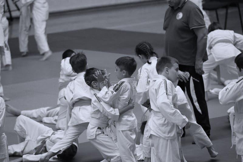 Jiu Jitsu junior fighters at Romanian Championship, Juniors, May 2018. Jiu Jitsu students in Kimono on tatami. Jiu-Jitsu Romanian Championship took place in royalty free stock photo