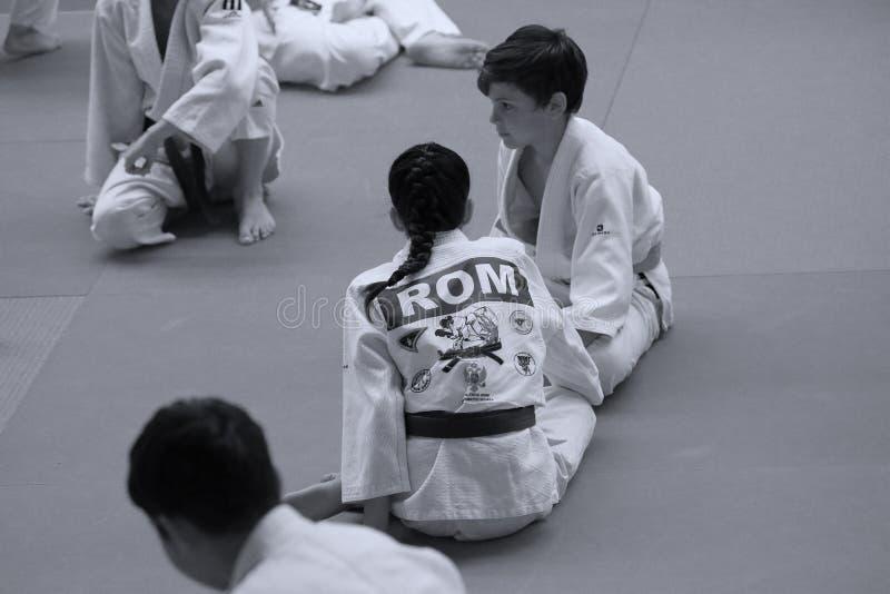 Jiu Jitsu junior fighting at Romanian Championship, Juniors, May 2018. Jiu Jitsu students in Kimono on tatami. Jiu-Jitsu Romanian Championship took place in stock photography