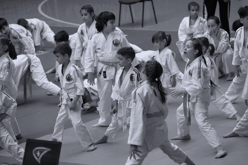 Jiu Jitsu junior fighting at Romanian Championship, Juniors, May 2018. Jiu Jitsu students in Kimono on tatami. Jiu-Jitsu Romanian Championship took place in royalty free stock photography