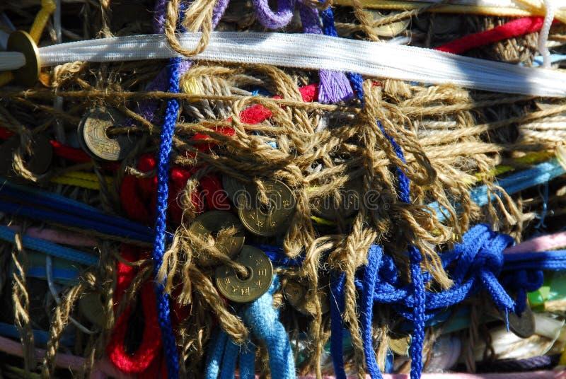 Jizo attaché de ficelle photos stock