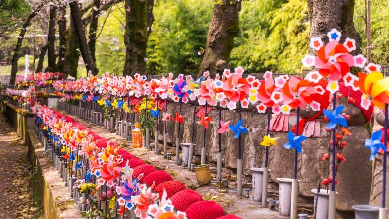 Jizo Japanese sculptures at Zojoji Temple in spring time at Tokyo Japan royalty free stock photo