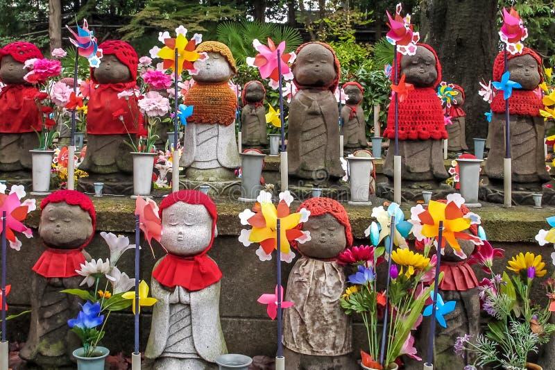 Jizo statues at the cemetery of Zojo-ji temple, Tokyo, Japan. Jizo statues at the cemetery of Zojo-ji temple in Tokyo, Japan royalty free stock image