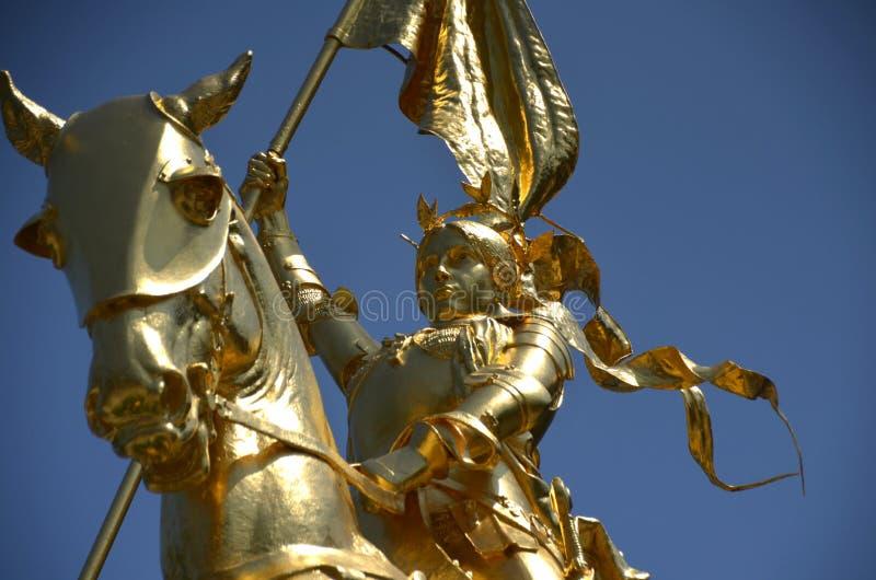 Joan of Arc. A gleaming golden statue of Joan of Arc in Philadelphia Pennsylvania stock image