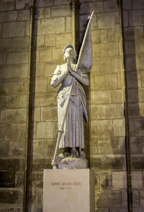 Joan of Arc statue inside of Notre-Dame de Paris cathedral, Paris. France, autumn season, November 2017 royalty free stock photography