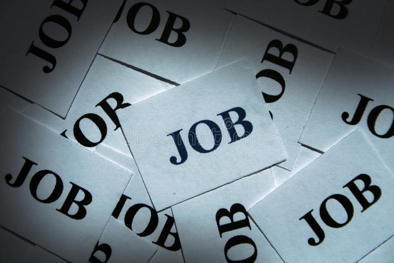 Job. Many pieces of paper with special text on it stock photo