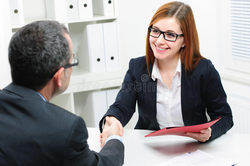 Job applicant having interview. Handshake while job interviewing royalty free stock photo