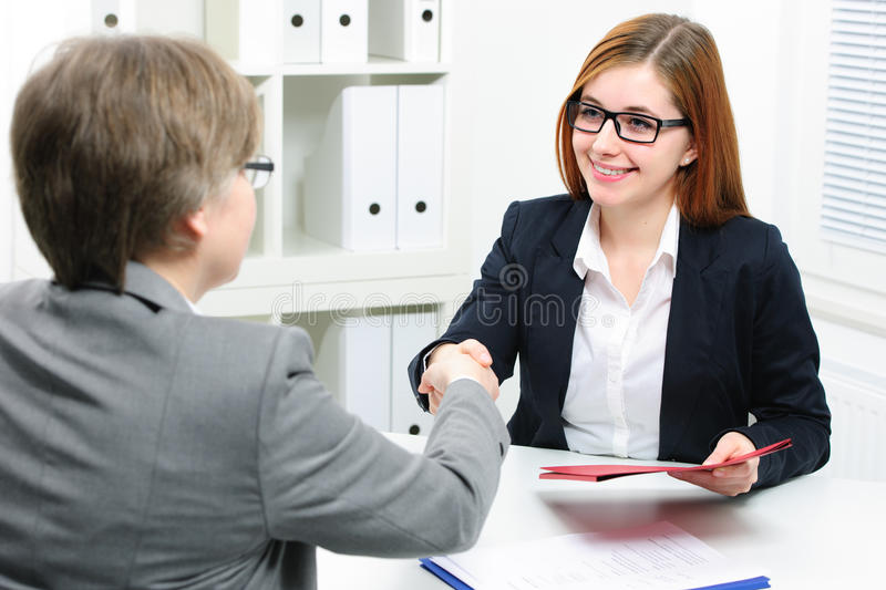 Job applicant having interview. Handshake while job interviewing stock photo