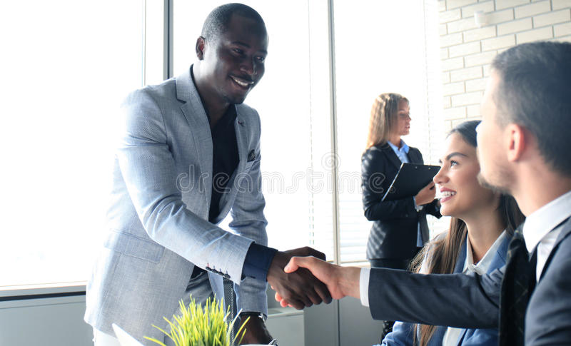 Job applicant having interview. Handshake while job interviewing royalty free stock photography