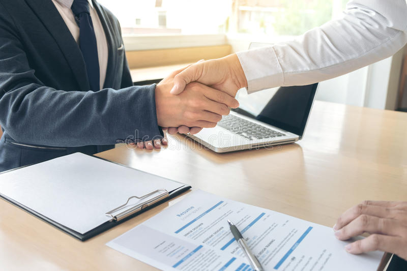 Job applicant having interview, Welcome to team Business people. Handshake with executive manager to Sign Approval Into the company, business meeting, Greeting stock image