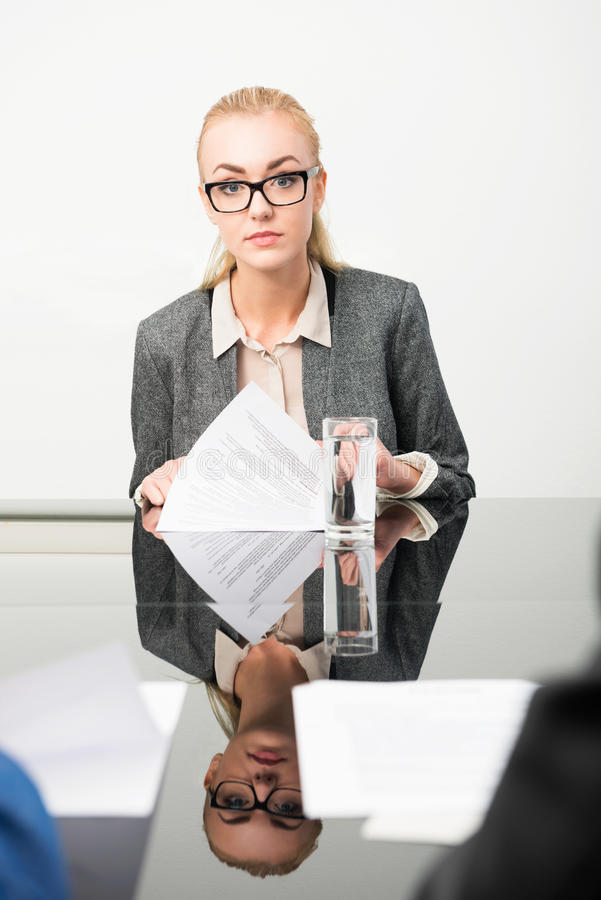 Job applicant. During her interview, with her resume in front of her royalty free stock photo