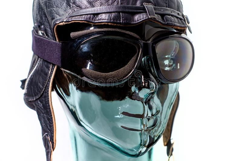 Job Automation Auto Pilot. Robotic humanoid wears aviator hat as job automation or auto pilot metaphor concept royalty free stock image