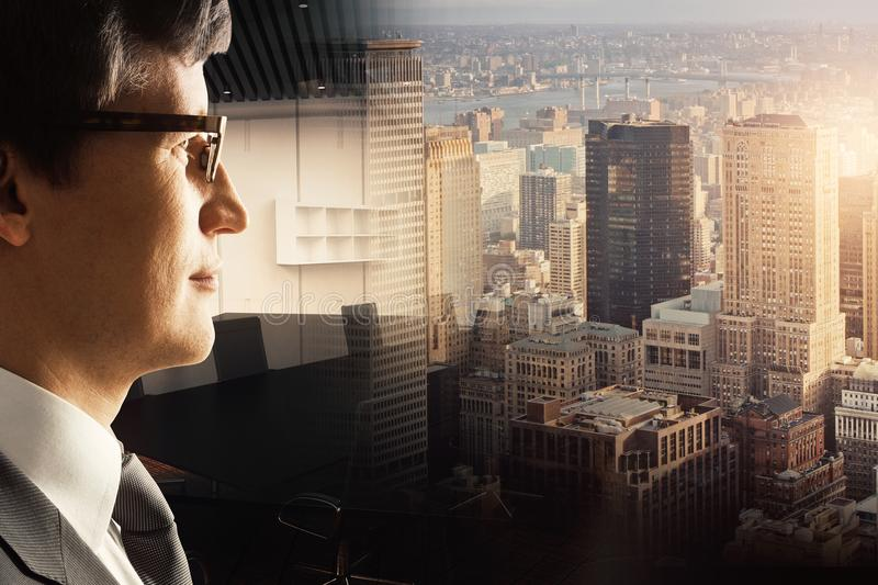 Job concept. Side view of attractive young businessman on abstract city and office background. Job concept. Double exposure royalty free stock photo