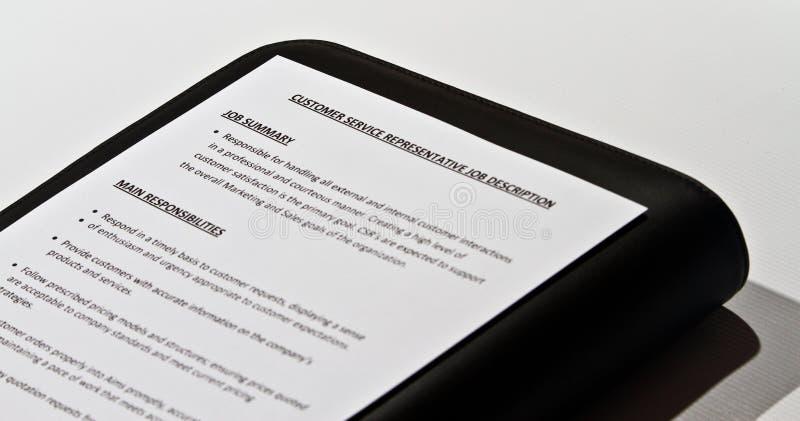 A Job Description. And a pen lying on a black case stock photos