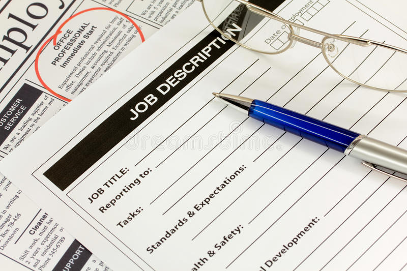 Job Description with Pen and Spectacles. Job Description with Pen and Newspaper Ad royalty free stock images