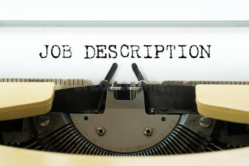 Job description word typed on a yellow vintage typewriter. Business concept.  stock photos