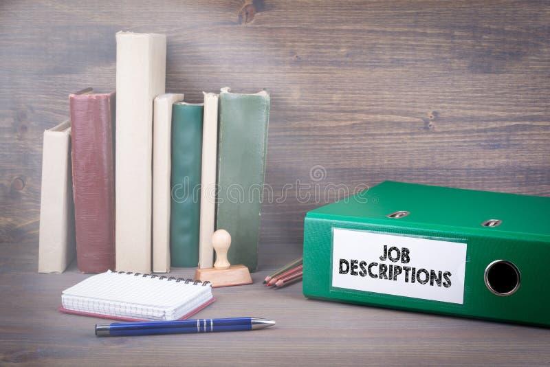 Job Descriptions. Binder on desk in the office. Business backgroundr. Job Descriptions. Binder on desk in the office. Business background stock photo