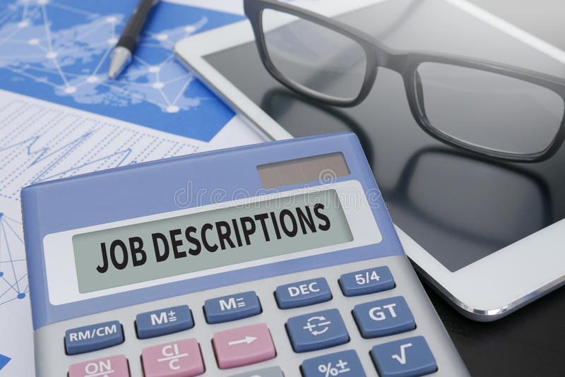 JOB DESCRIPTIONS. Calculator on table with Office Supplies. ipad royalty free stock photo