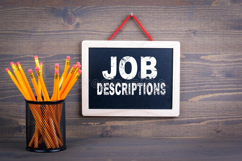 Job Descriptions. Career and success concept. Chalkboard on a wooden background.  royalty free stock photos
