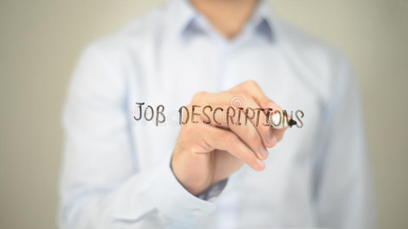 Job Descriptions , Man writing on transparent screen. High quality stock photo