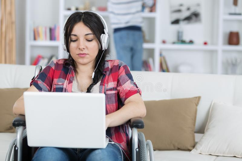 Job for disabled people woman on wheelchair with laptop. Job for disabled people women on wheelchair with laptop female stock photography