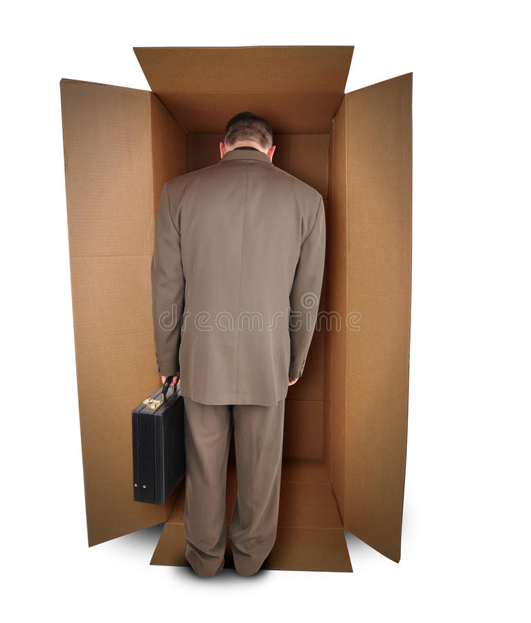 Job infelice dell'uomo di affari in casella fotografia stock