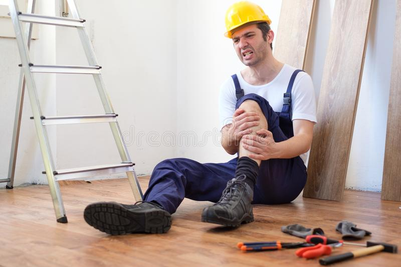 On the job injury of one worker just fallen from a ladder stock photos