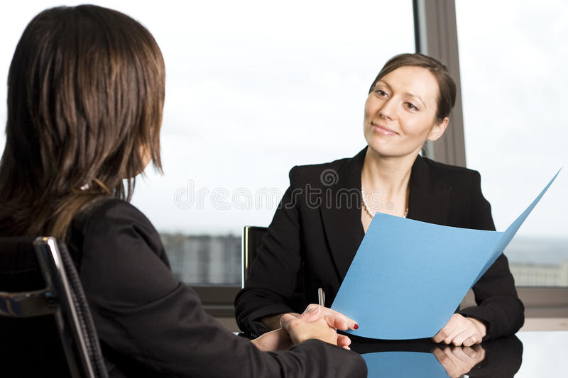 Job Interview. Two woman and during a job interview, in the background you can see the skyline of Barcelona