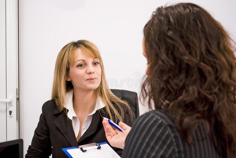 Job interview. Young woman being interviewed for a job