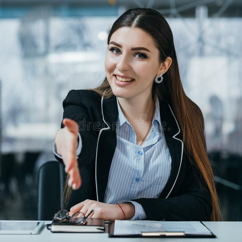 Confident company headhunter welcome workplace. Job interview. Confident headhunter extending welcoming hand. Office workplace royalty free stock image