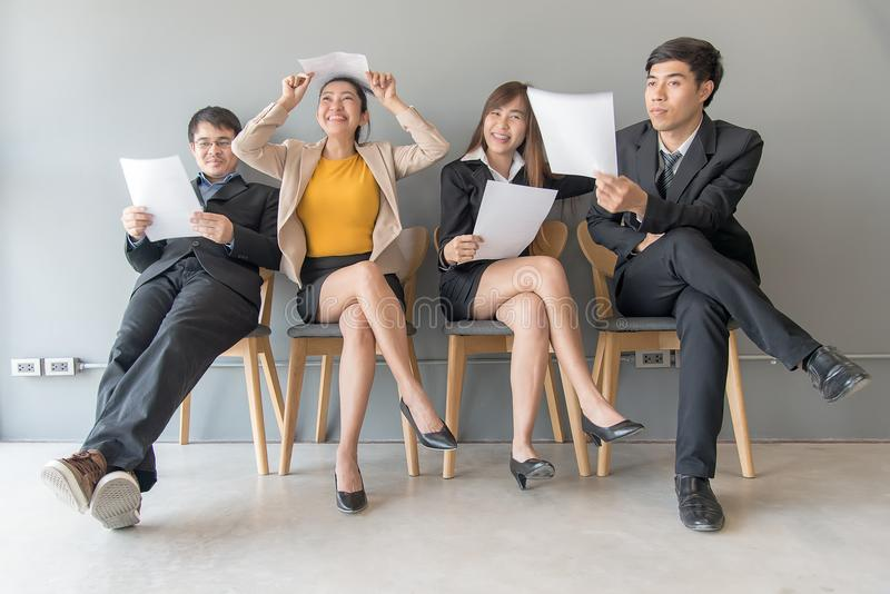 Job Interview. Group of asian people review document while waiting for job interview stock photo