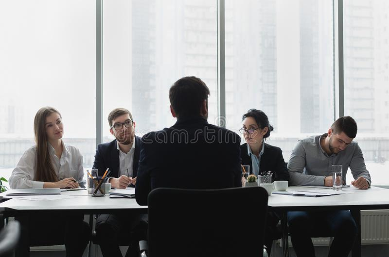 Job interview. HR managers talking with candidate royalty free stock image