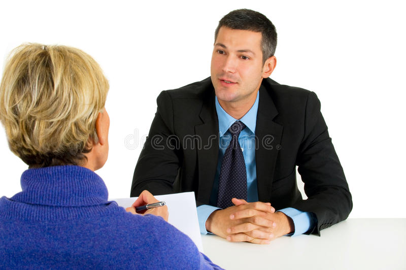 Job interview with man and woman. In white background stock photo