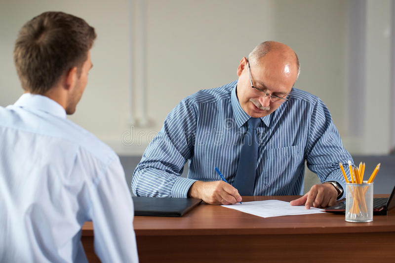 Job interview, senior manager and young apprentice stock photography