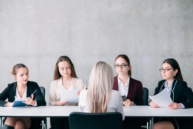 Job interview recruiter team members hiring staff. Job interview. Staffing and hiring. Blonde female talking to recruiter team members royalty free stock photos